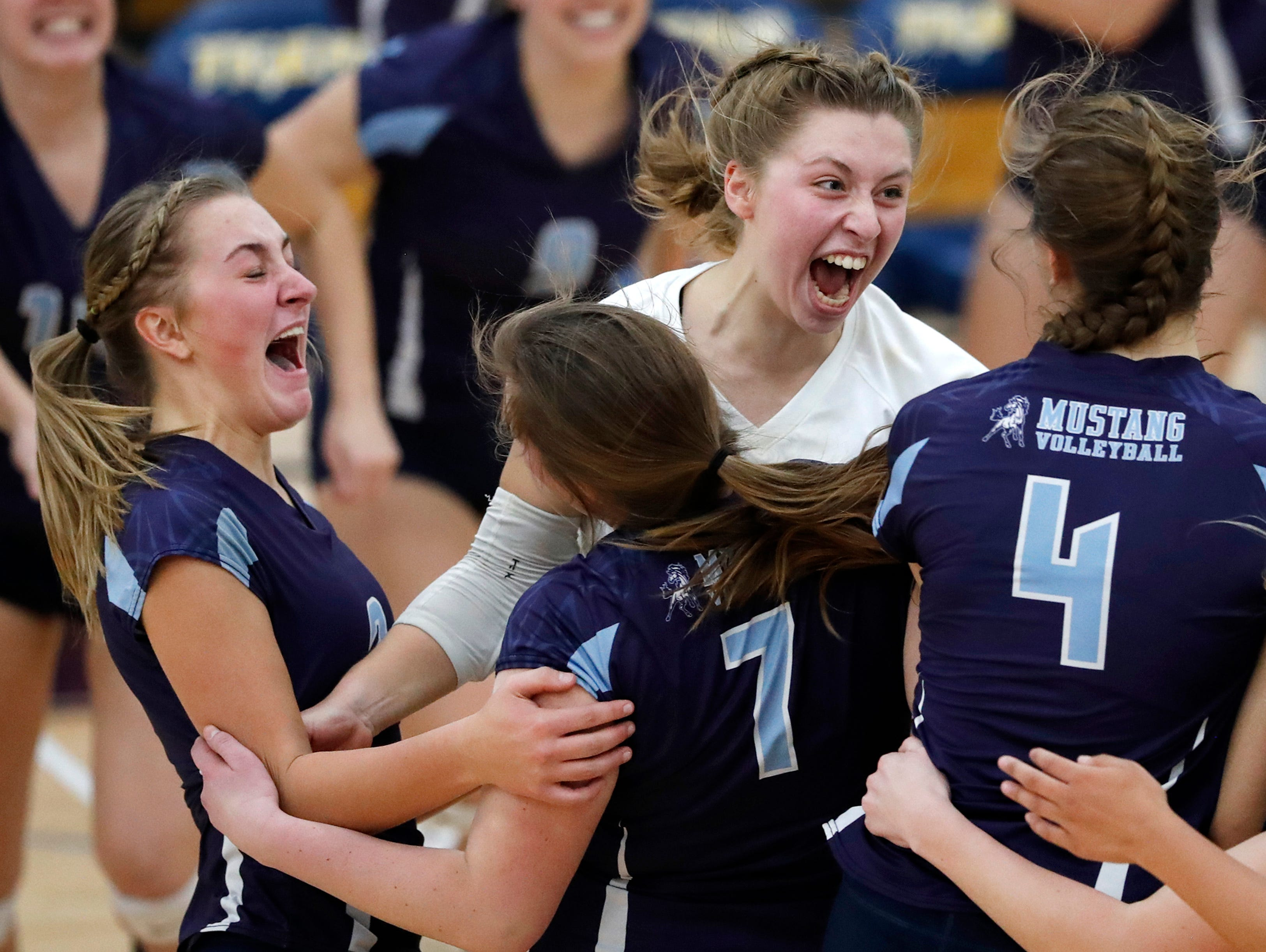 Little Chute High School's Gabi Roemer, Katherine Joten, Emma Ciske, and Hannah VandenBerg celebrate after defeating Xavier High School in the fifth set during their Division 2 semifinal match Thursday, Oct. 25, 2018, in Chilton, Wis.