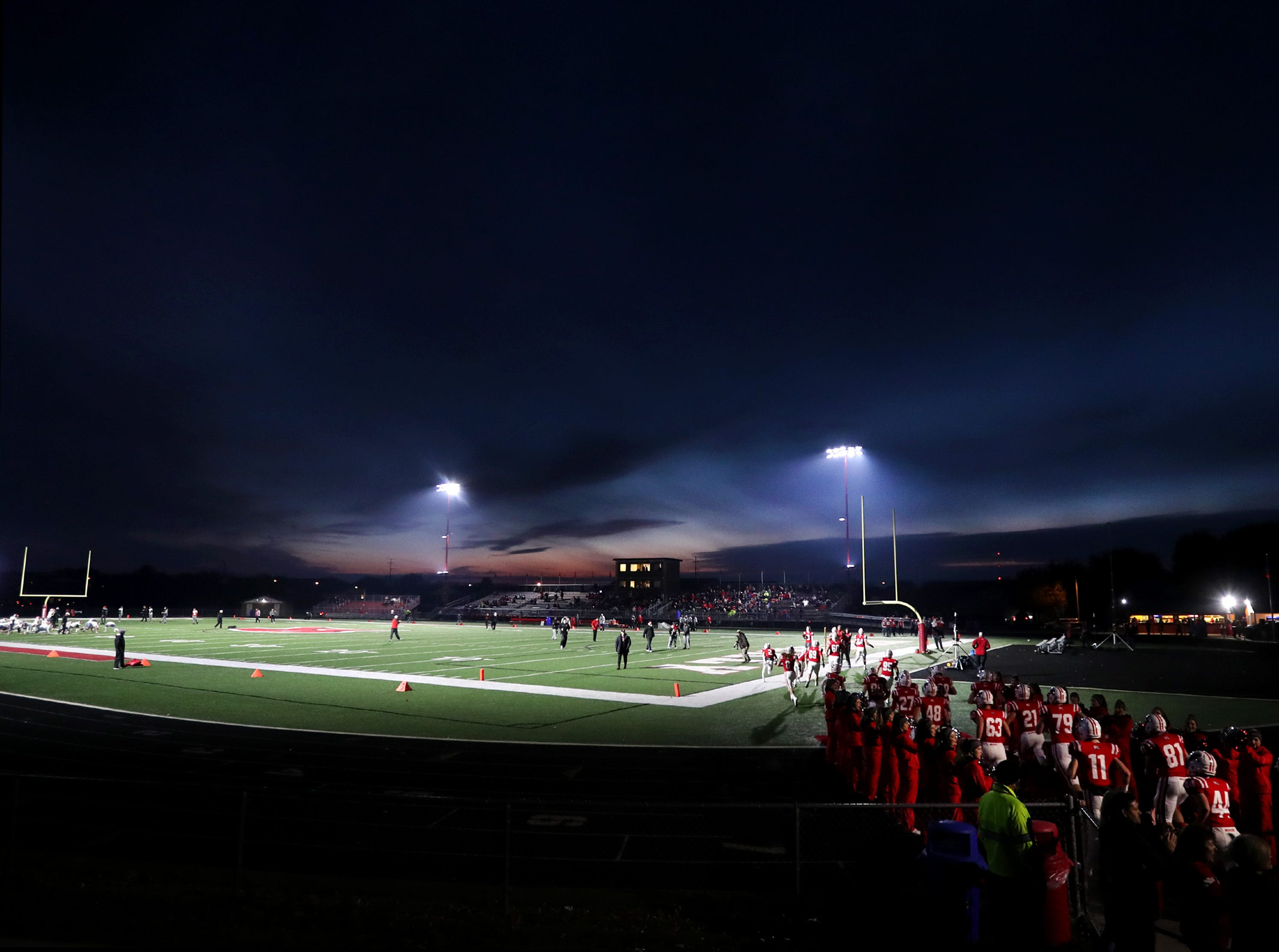 Kimberly High School players take to the field before their round 2 playoff game against Neenah High School Friday, Oct. 26, 2018, in Kimberly, Wis.