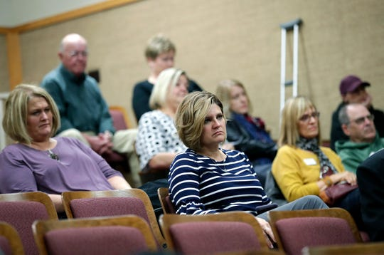 Attendees listen Tuesday during a community event on domestic violence held at the University of Wisconsin-Fox Valley in Menasha.