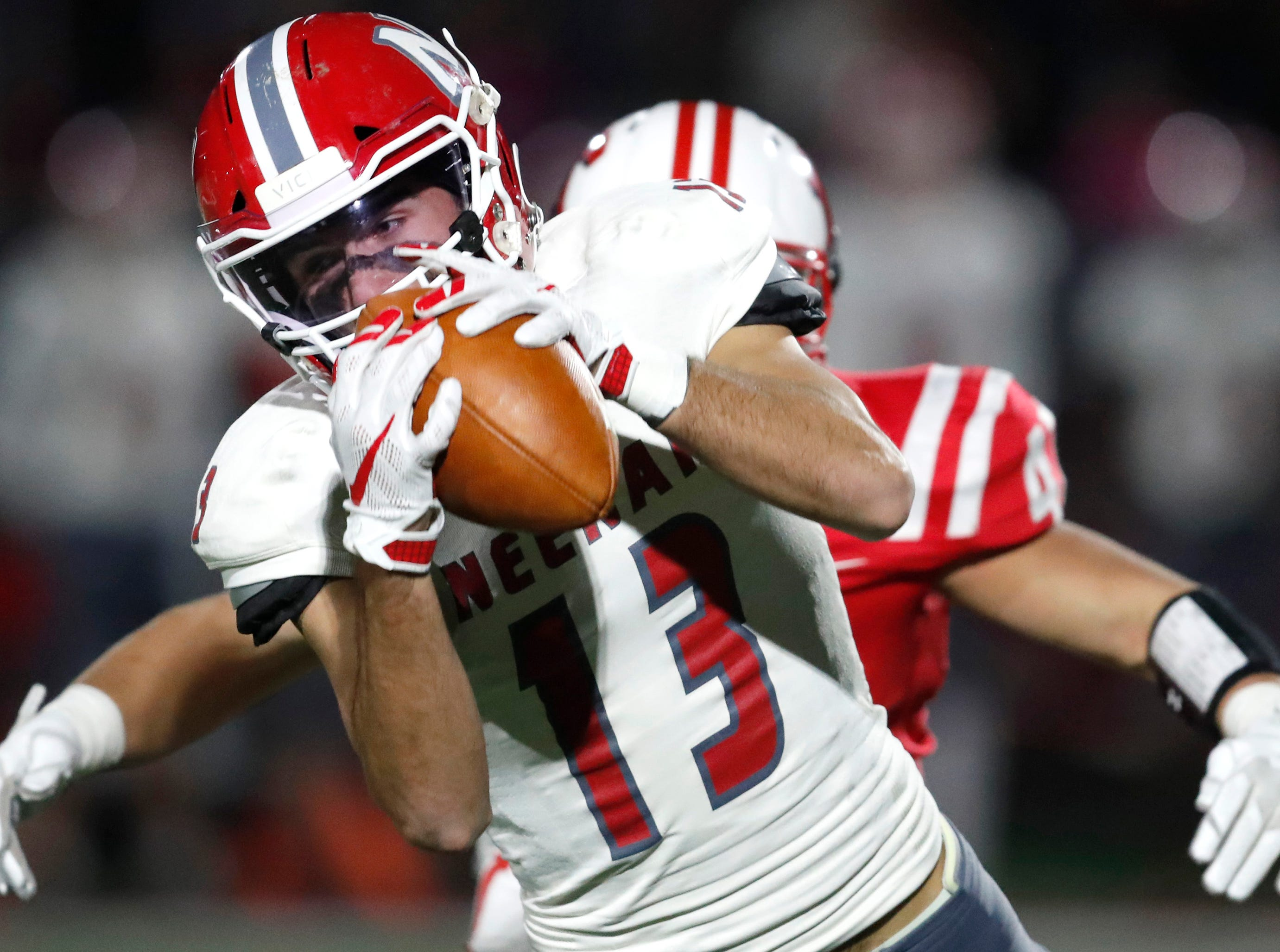 Neenah High School's Logan Morrow makes a catch against Kimberly High School during their round 2 playoff game Friday, Oct. 26, 2018, in Kimberly, Wis.