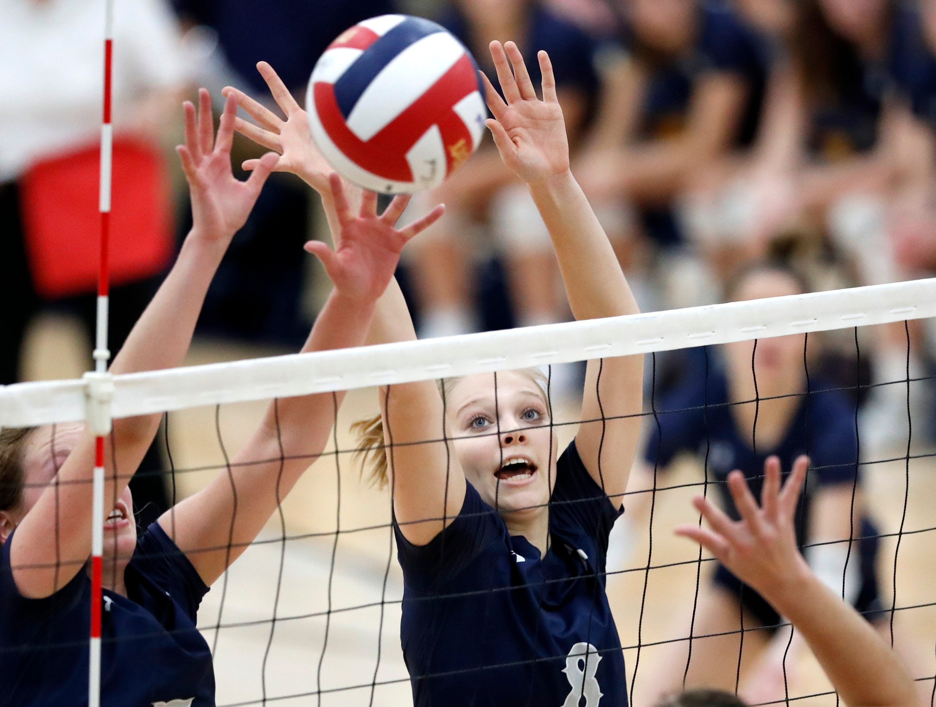 Xavier High SchoolÕs Emma Vosters and Xavier High SchoolÕs Morgan Michalkiewicz try to block a shot from Little Chute High School during their Division 2 semifinal match Thursday, Oct. 25, 2018, in Chilton, Wis.Danny Damiani/USA TODAY NETWORK-Wisconsin