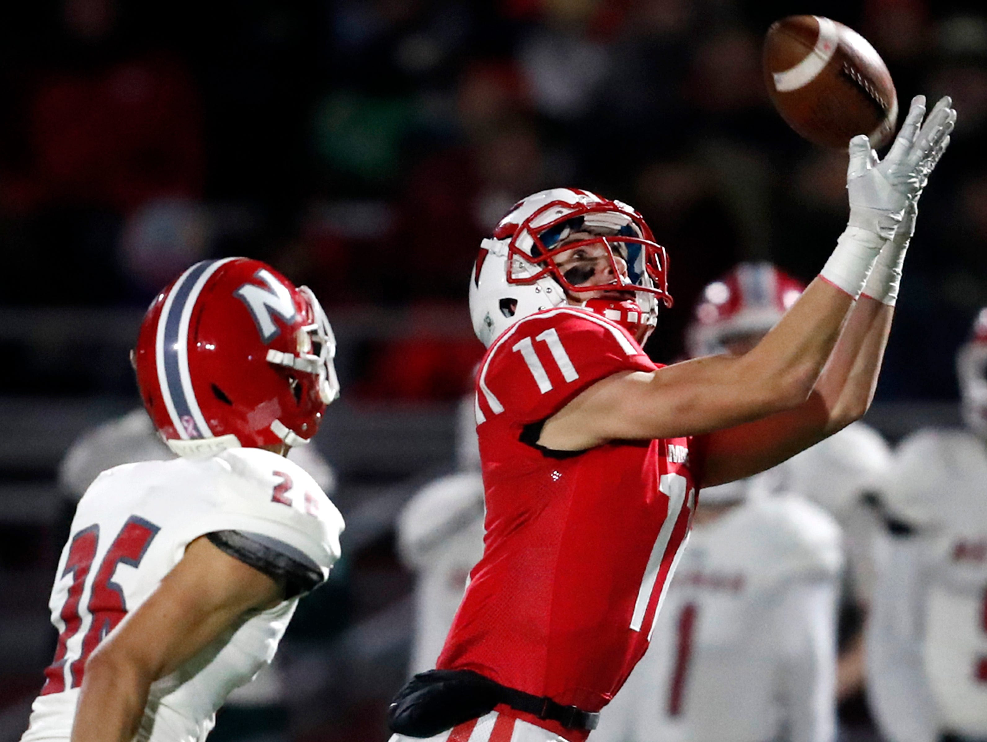 Kimberly High SchoolÕs Conner Wnek makes a catch while being covered by Neenah High School's Jack VanDyke during their round 2 playoff game Friday, Oct. 26, 2018, in Kimberly, Wis.Danny Damiani/USA TODAY NETWORK-Wisconsin