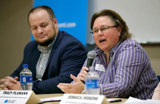 Tracy Plamann, community education coordinator for Harbor House Domestic Abuse Programs, answers a panel question during A Community Conversation about Domestic Violence Tuesday at the University of Wisconsin-Fox Valley in Menasha. At left is fellow panel member Cullin Conklin, HR representative for Guardian Life Insurance.