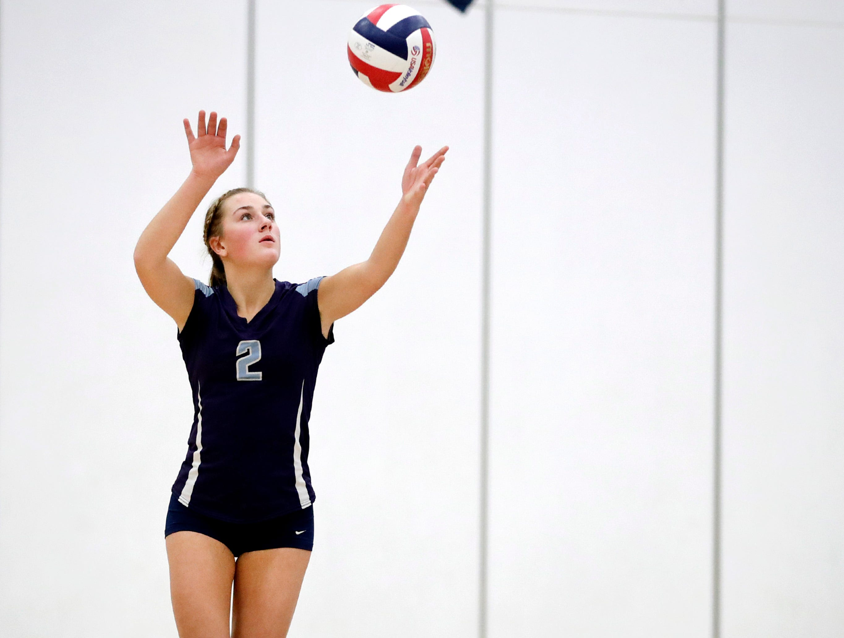 Little Chute High SchoolÕs Gabi Roemer serves to Xavier High School during their Division 2 semifinal match Thursday, Oct. 25, 2018, in Chilton, Wis.
