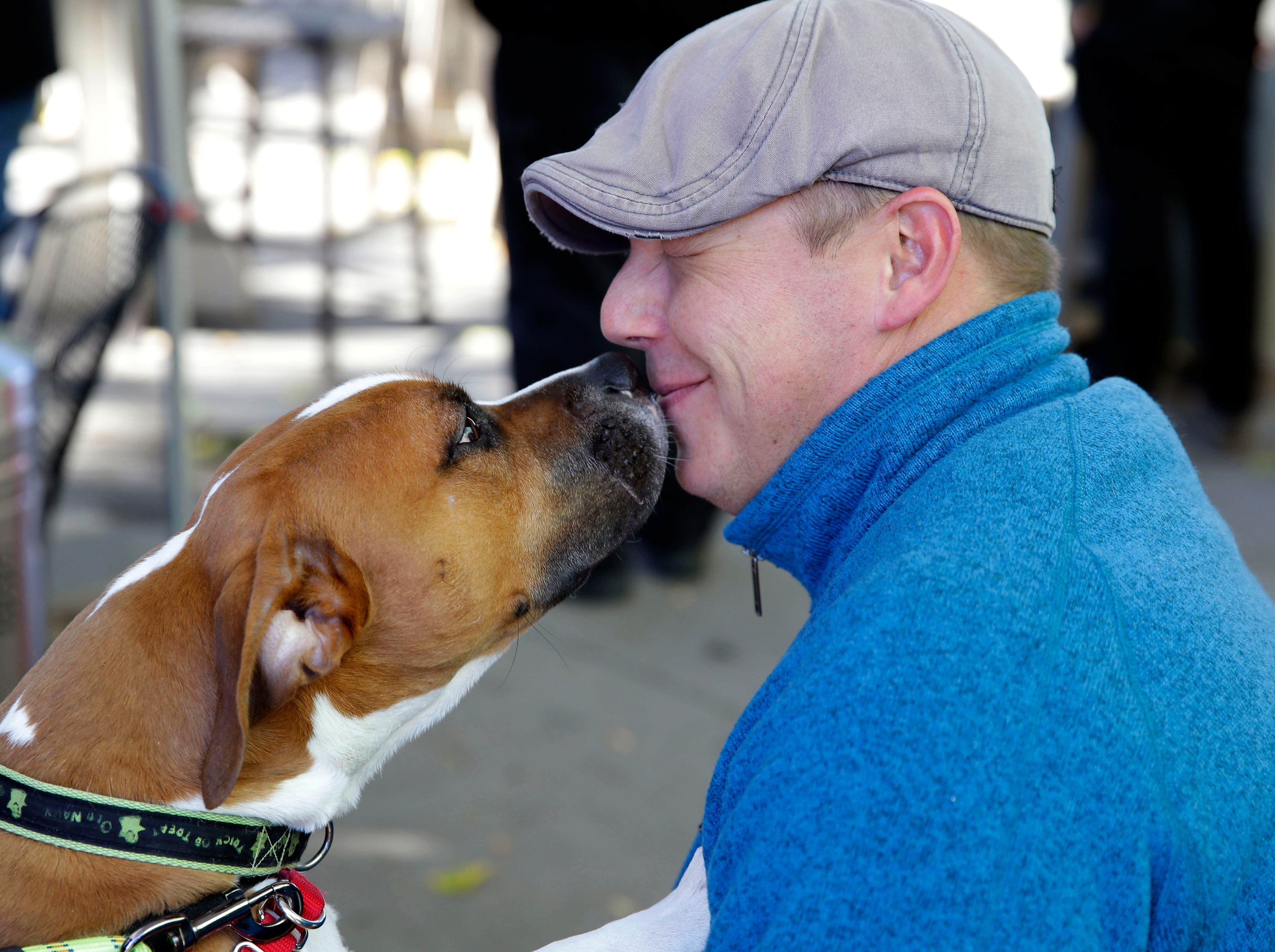 Jackson pays a visit to Jason Beatty during Dogtoberfest as adoptable dogs from the Fox Valley Humane Association are shown Saturday, October 20, 2018, at Fox River House in Appleton, Wis.Ron Page/USA TODAY NETWORK-Wisconsin