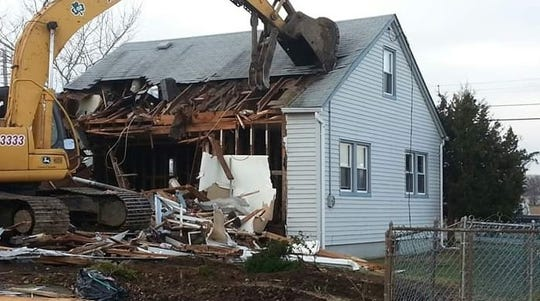 The Ebners' Union Beach home getting torn down after Sandy.