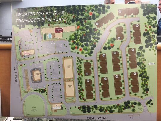 The photo shows a rendering on display at Ocean Township of a mixed-use plan for retail, commercial and residential uses for a 31 parcel at the corner Deal Road and Route 35 in Ocean.