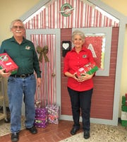 Gary and Joyce Gemoets with Christmas presents ready to send as part of Operation Christmas Child.
