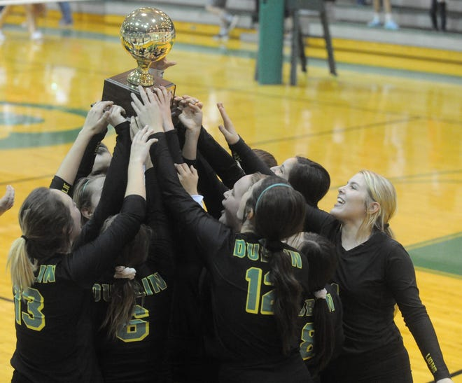 The Dublin volleyball team holds up its bi-district championship trophy after defeating Jim Ned in three sets Tuesday, Oct. 30, 2018 at Bangs High School.