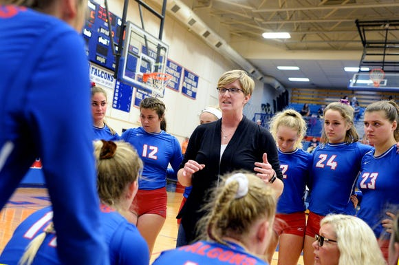 West Henderson coach Tiffany Lowrance talks with her team between matches in the game against Jesse Carson in Hendersonville Oct. 30, 2018.