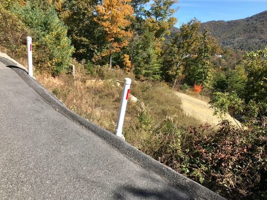 The lot at 145 Black Oak Drive in Beaverdam, site of a slope failure in 2013 that resulted in the condemnation of a house, has been graded. A home could be built there again, with proper engineering and architectural input. The neighborhood had to rebuild the road above the lot.