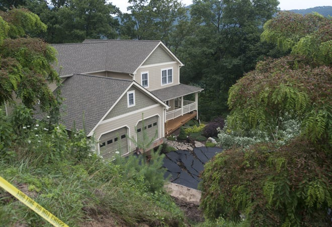 In July 2013, heavy rains and a slope failure caused severe damage to this home at 145 Black Oak Drive in Beaverdam. The home was condemned by Buncombe County officials and had to be demolished.