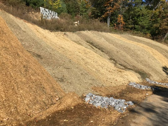 The lot at 145 Black Oak Drive in Beaverdam, site of a slope failure in 2013 that resulted in the condemnation of a house, has been graded. A home could be built there again, with proper engineering and architectural input.