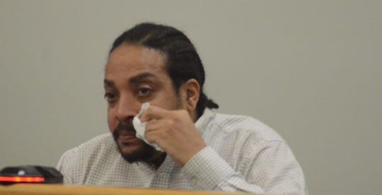 Trent Davis wipes away tears as he testifies Wednesday, Oct. 31, 2018.
