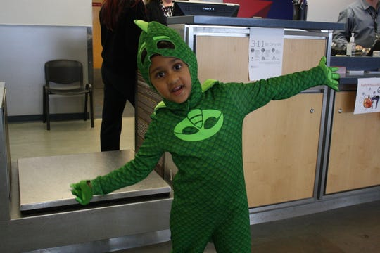 Amir Tandon, 10, of Endicott, portrayed Gekko from the television show PJ Masks to trick-or-treat at Halloween at the Airport Wednesday.