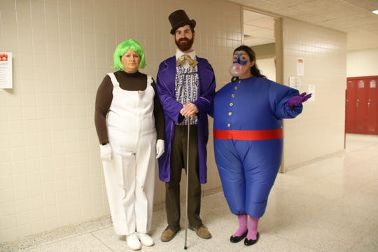 From left: Johnson City High School announces its show title every year on Halloween by dressing as the musical's characters. Julie Beard, Johnson City High School coordinator of music, dressed as an Oompa-Loopma; Andrew Chadwick, high school orchestra director, dressed as Willy Wonka; and Jennifer Chudacik, high school choral director, dressed as Violet Beauregarde.