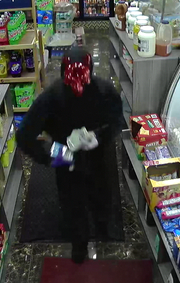 Two suspects robbed Prince Deli on Monday wearing red devil masks.