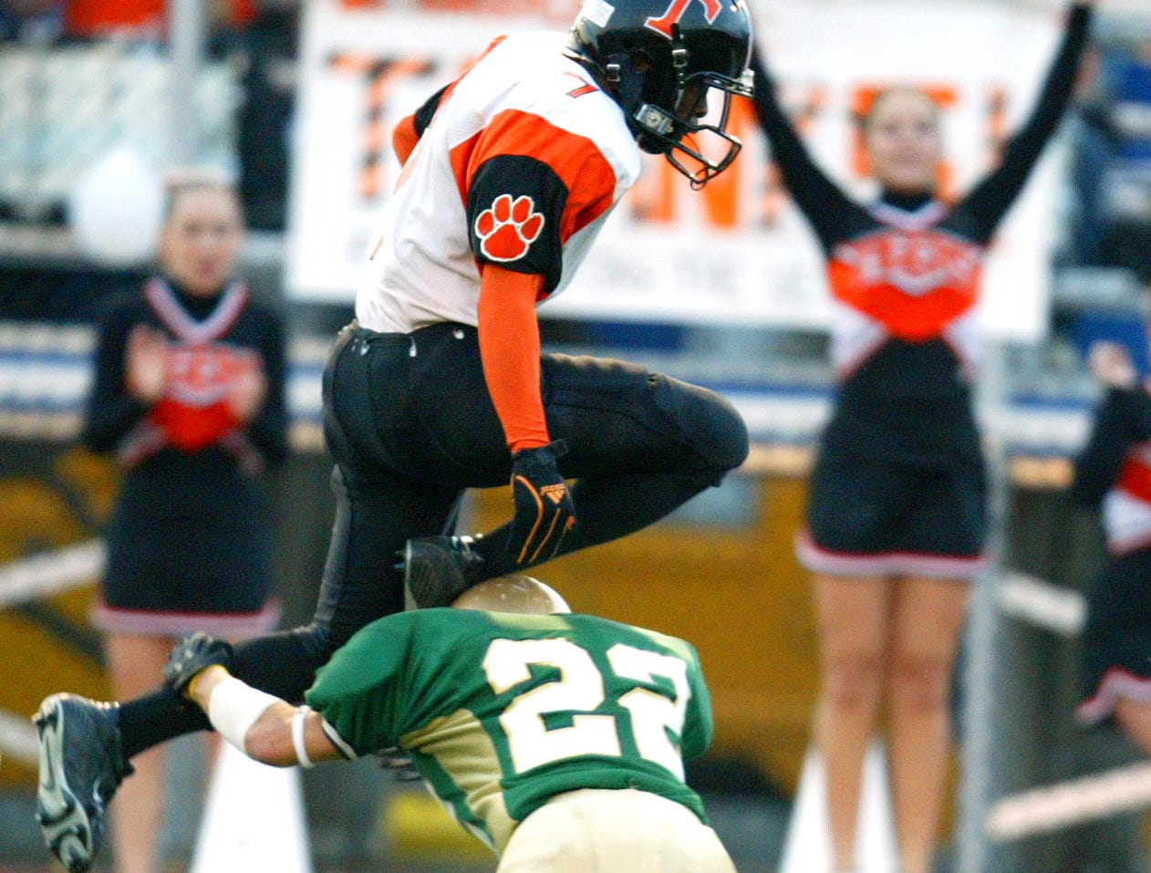 Union-Endicott's Jermaine Thomas jumps over Vestal's Chris Dutkowsky during a kickoff return in the second quarter during Class 'AA' Section IV championships against Vestal at Binghamton Alumni Stadium in 2006.
