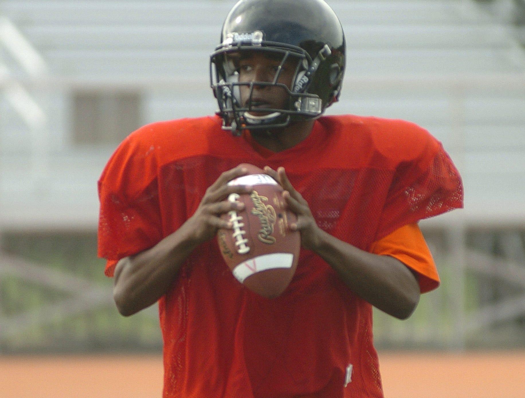2003 Union-Endicott quarterback Jermaine Thomas looks for a receiver during practice.