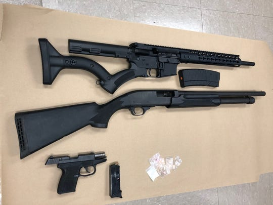 Authorities recovered an AR-15 rifle,12-gauge shotgun, 9mm handgun, cocaine and ecstasy.
