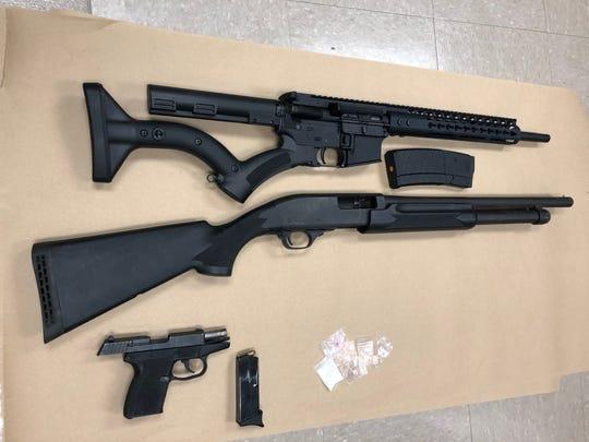Authorities recovered an AR-15 rifle,12-gauge shotgun, 9mm handgun, cocaine and ecstasy.