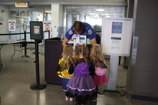 Participants in the Greater Binghamton Airport's Halloween at the Airport event trick-or-treated at various locations throughout the airport.