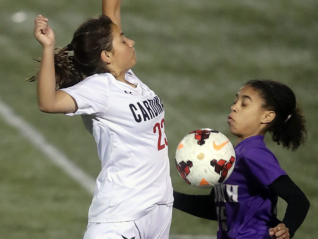 Orting's Peyton Hamilton (left) and North Kitsap's in Kamora McMillian battle for control of the ball in Poulsbo on Tuesday, October 30, 2018.