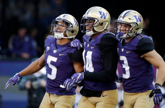 From left, Washington defensive backs Myles Bryant, JoJo McIntosh and Elijah Molden celebrate after Bryant recovered a UCLA fumble during a 2017 game in Seattle.