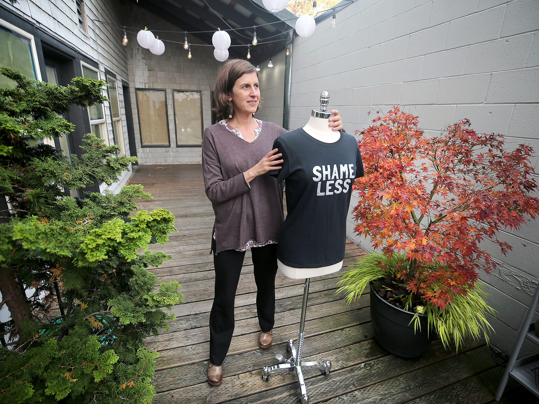 "Rebecca Hall is the owner of SHiFT, a new boutique off Winslow Way, on Bainbridge Island, that sells ""ethical fashion,"" clothes like upcycled shirts made by women in Honduras and Cambodia or bags or wallets fashioned from bicycle inner tubes. The idea is all the products will be made in a socially conscious way both for the workers who make them and for the planet."