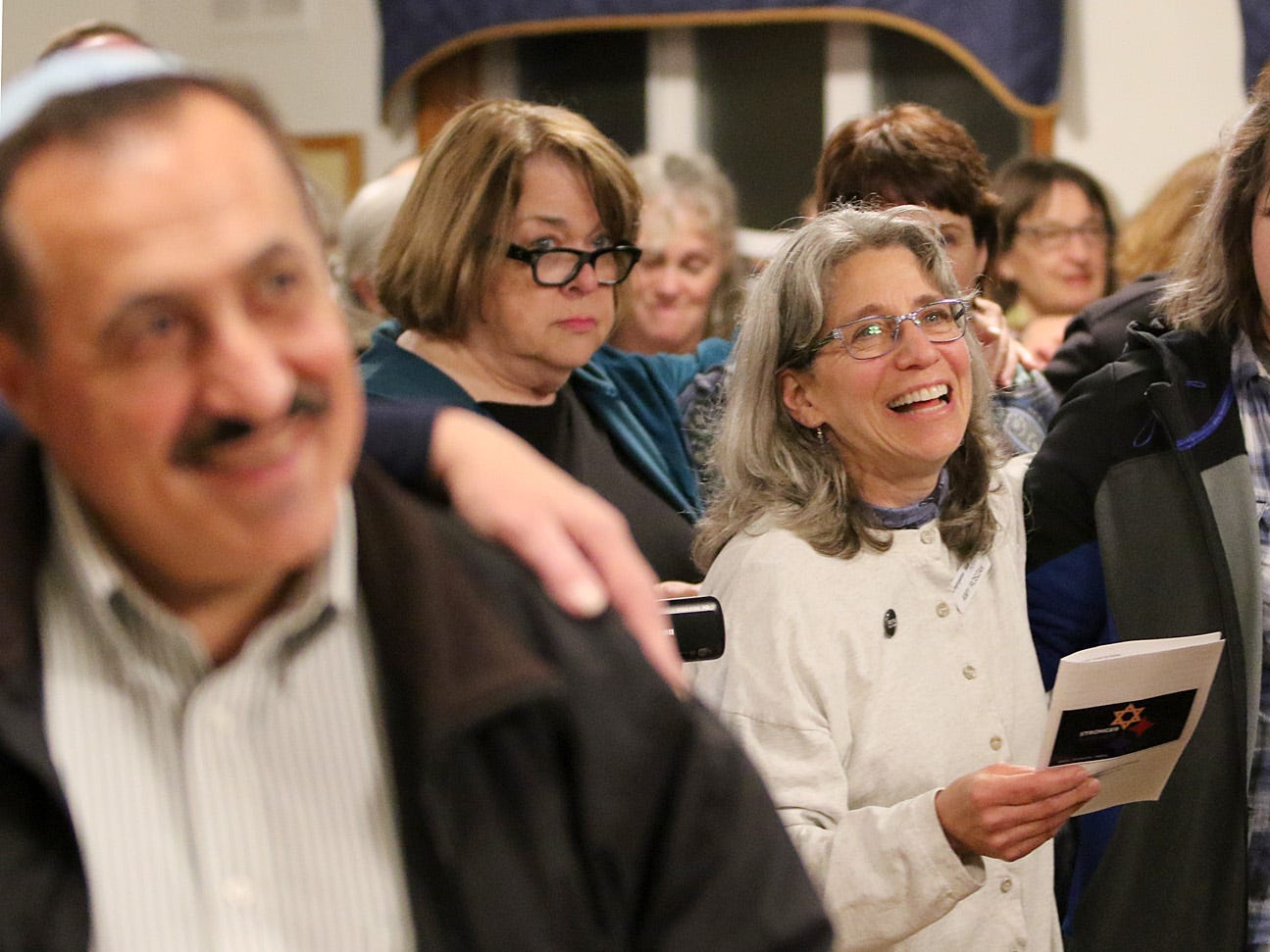 """The Beth Hatikvah (House of Hope) Synagogue in Bremerton held a memorial service for the Tree of Life Synagogue shootings Tuesday night in Bremerton.  Th congregation joins in singing """"This Little Light of Mine"""" during the service."""