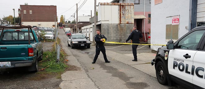Bremerton Police tape of the scene of an explosion in a parking lot and alleyway off of 6th in downtown Bremerton on Wednesday, October 31, 2018.