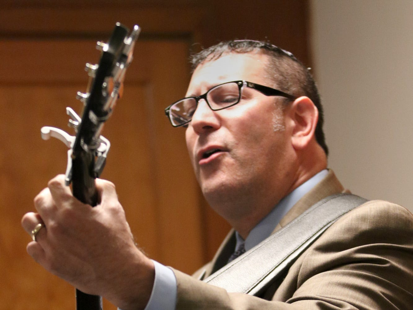 Rabbi Mitch Delcau leads the congregation in song during the memorial.   The Beth Hatikvah (House of Hope) Synagogue in Bremerton held a memorial service for the Tree of Life Synagogue shootings Tuesday night in Bremerton.