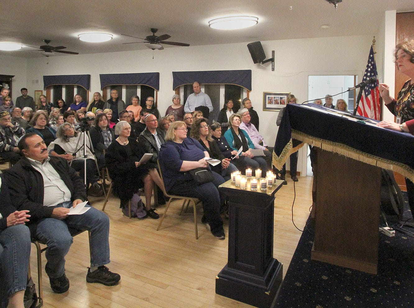 The Beth Hatikvah (House of Hope) Synagogue in Bremerton held a memorial service for the Tree of Life Synagogue shootings Tuesday night in Bremerton. Poulsbo Mayor Becky Ericson talks to the standing room only crowd inside the synagogue.