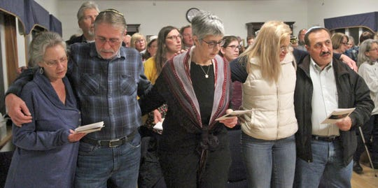 The Beth Hatikvah (House of Hope) Synagogue in Bremerton held a memorial service for the Tree of Life Synagogue shootings Tuesday night in Bremerton. Joining in song during the service were, from left, Robin and Tom Headrick, of Ollala, Pam Loginsky, of Port Orchard, and Liz and Shabaz Naftehi, of Port Orchard.