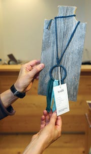 A handmade necklace made from recycled materials will be for sale at SHiFT when it opens Thursday.