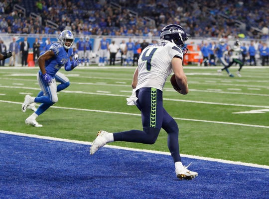 Seahawks punter Michael Dickson ran the ball out of the end zone for nine yards and a first down to clinch Sunday's win over the Lions.