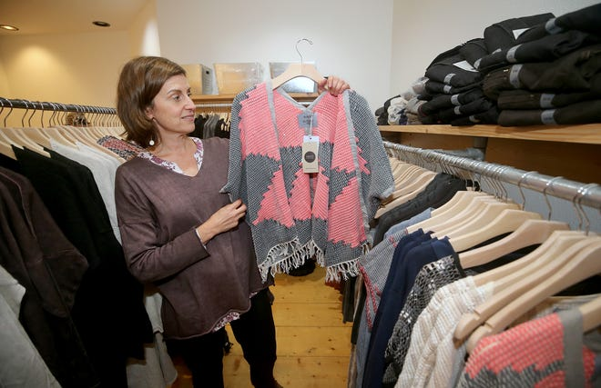 """Rebecca Hall is the owner of SHiFT, a new boutique off Winslow Way on Bainbridge Island that sells """"ethical fashion."""" Offerings include upcycled T-shirts made by women in Honduras and Cambodia or bags or wallets fashioned from bicycle inner tubes."""