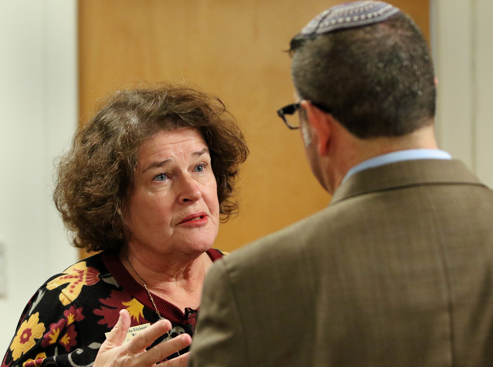 Poulsbo Mayor Becky Erickson shares her thoughts with Rabbi Mitch Delcau before the memorial serivice fot the shootings in Pittsburg.  The Beth Hatikvah (House of Hope) Synagogue in Bremerton held a memorial service for the Tree of Life Synagogue shootings Tuesday night in Bremerton.