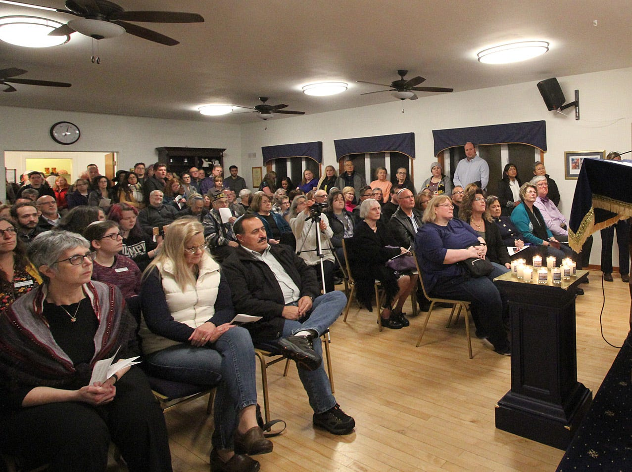 The Beth Hatikvah (House of Hope) Synagogue in Bremerton held a memorial service for the Tree of Life Synagogue shootings Tuesday night in Bremerton. Rabbi Mitch Delcau speaks to his congregation.