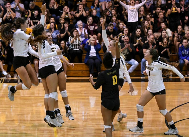 Merritt Island players celebrate a point during Tuesday regional semifinal against Bishop Moore.