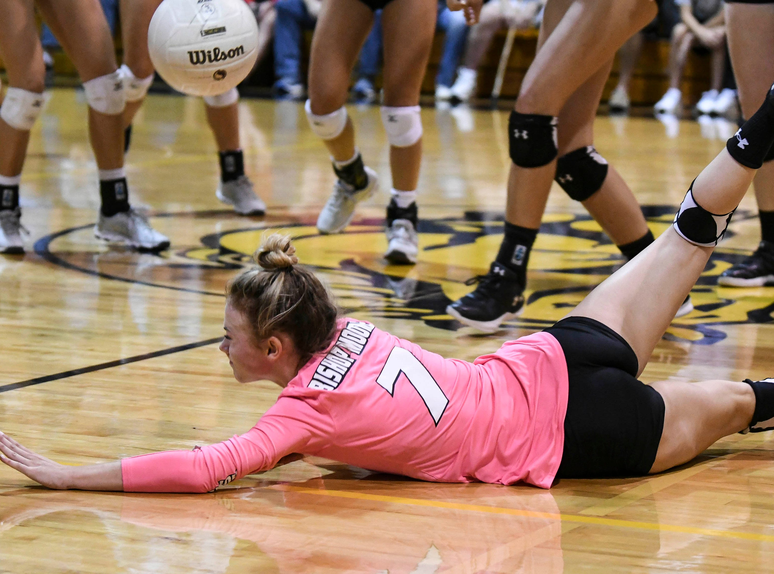 A Bishop Moore player dives for a ball during Tuesday volleyball regional semifinal against Merritt Island.