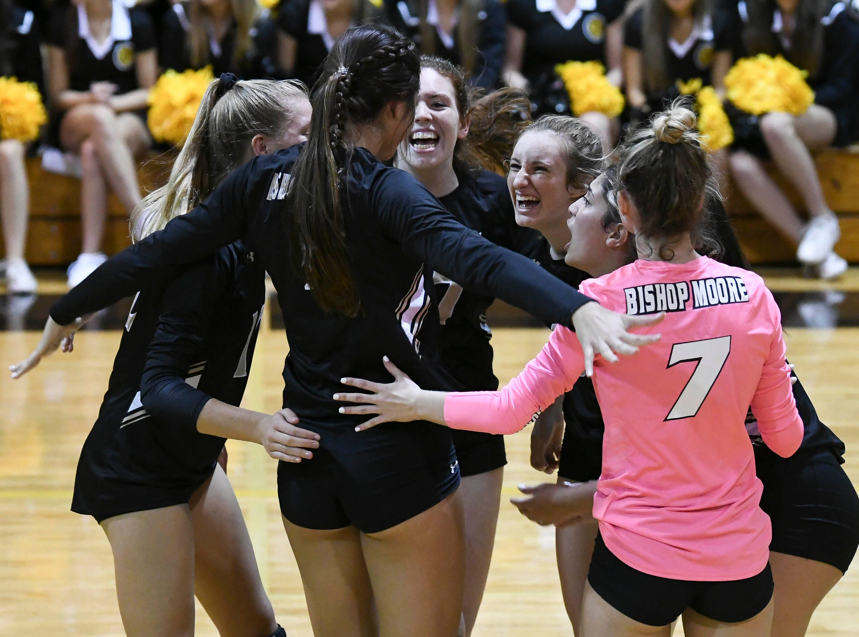 Bishop Moore players celebrate a point during Tuesday regional semifinal against Merritt Island.