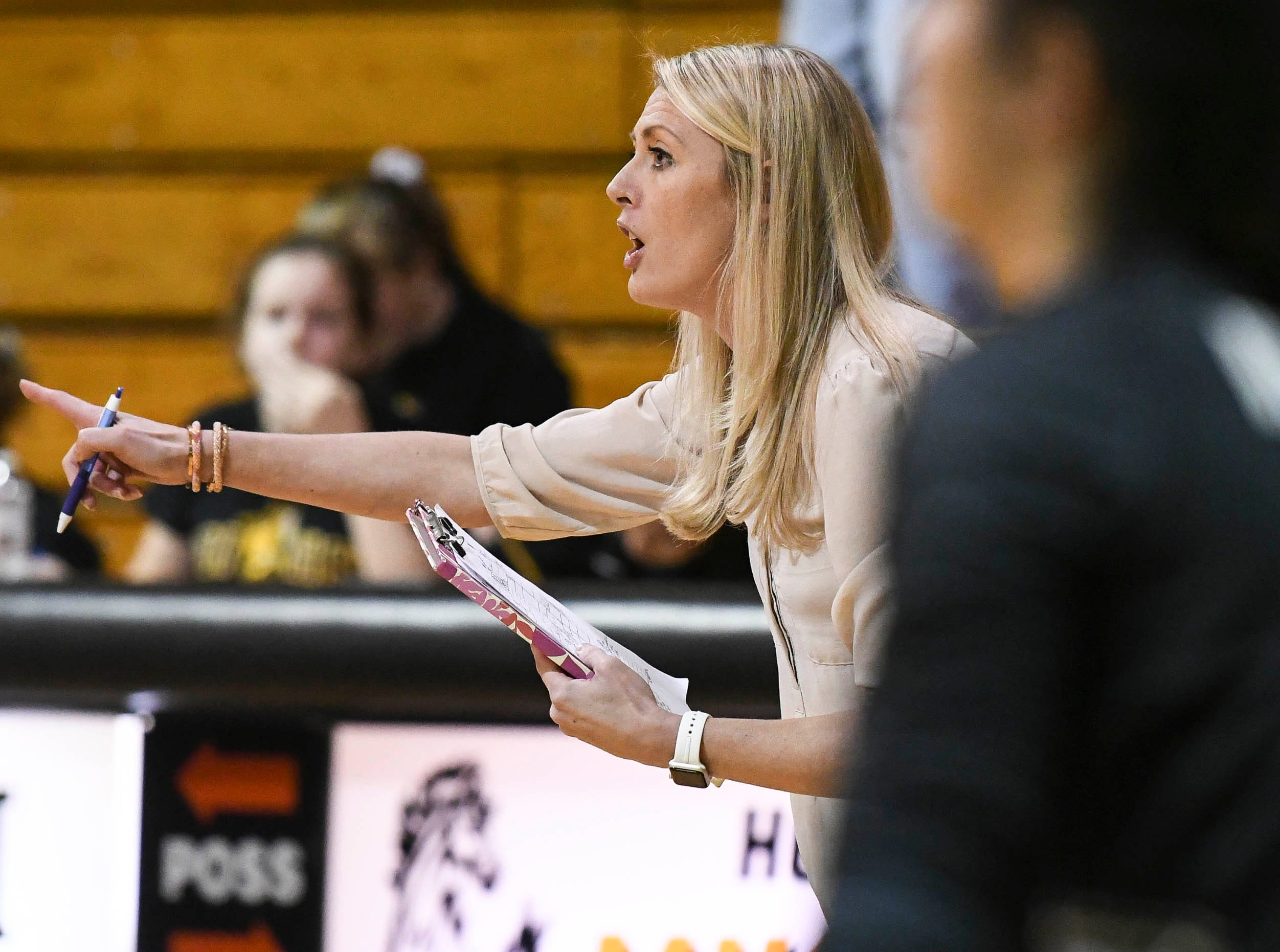 Bishop Moore volleyball coach Tanya Jarvis instructs her team during Tuesday volleyball regional semifinal.