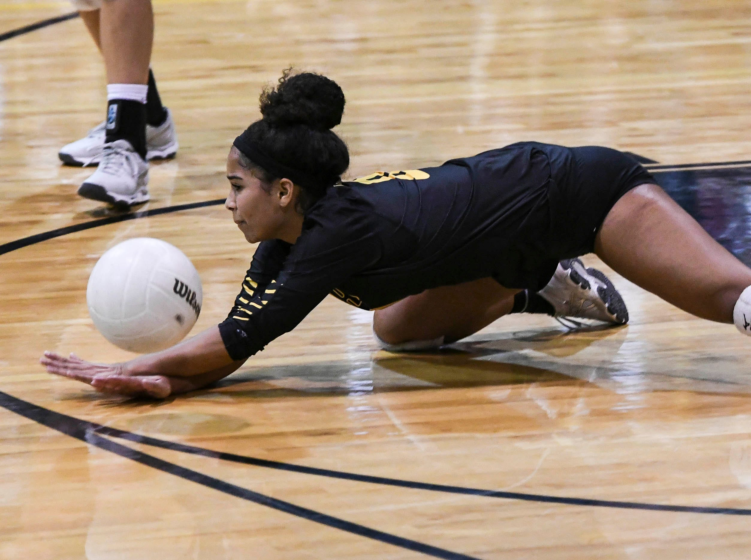 Jasmine Sayre of Merritt Island dives for a ball during Tuesday volleyball regional semifinal.