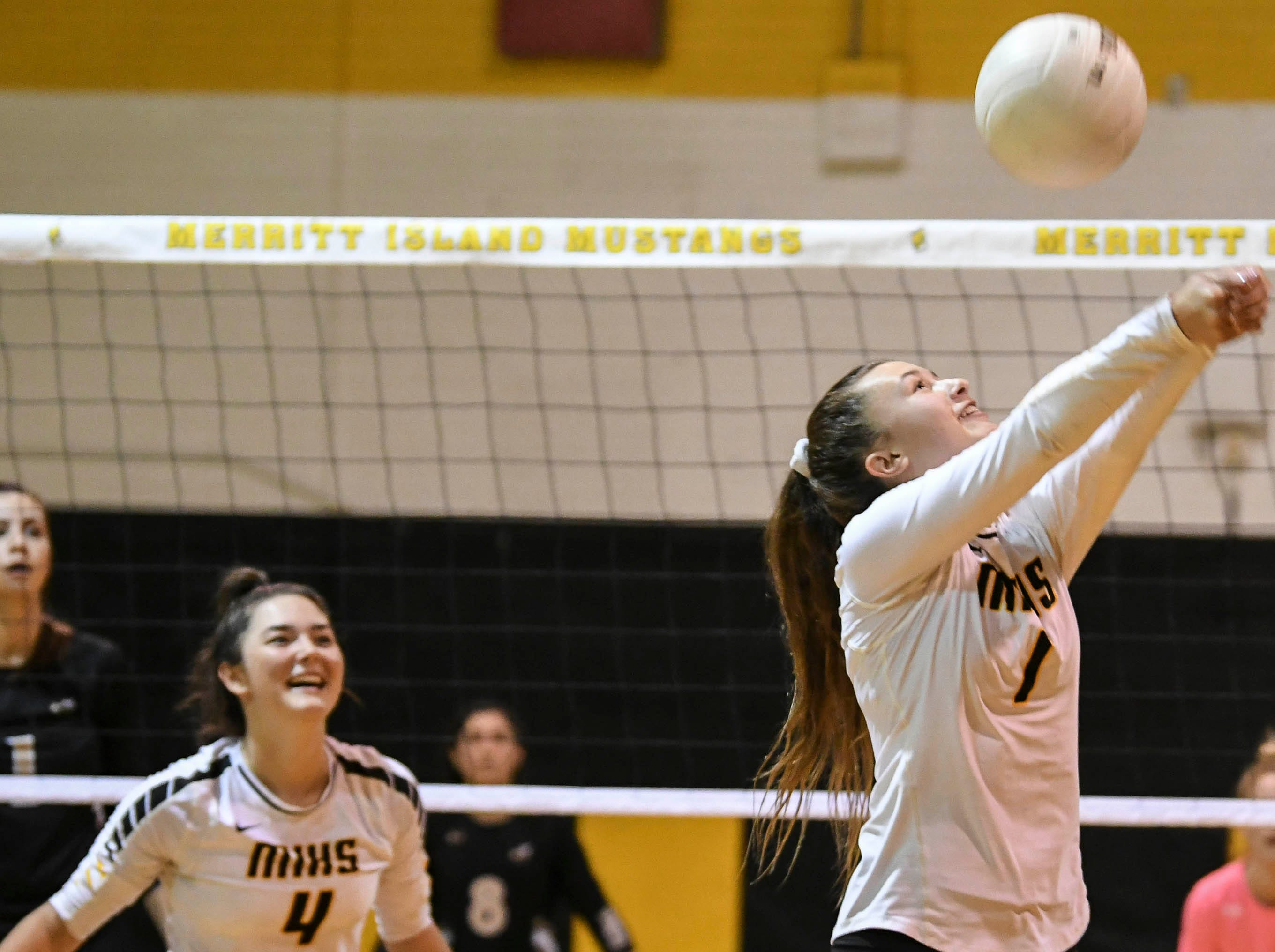 Macy Reynolds of Merritt Island sends the ball back over the net during Tuesday regional semifinal against Bishop Moore.