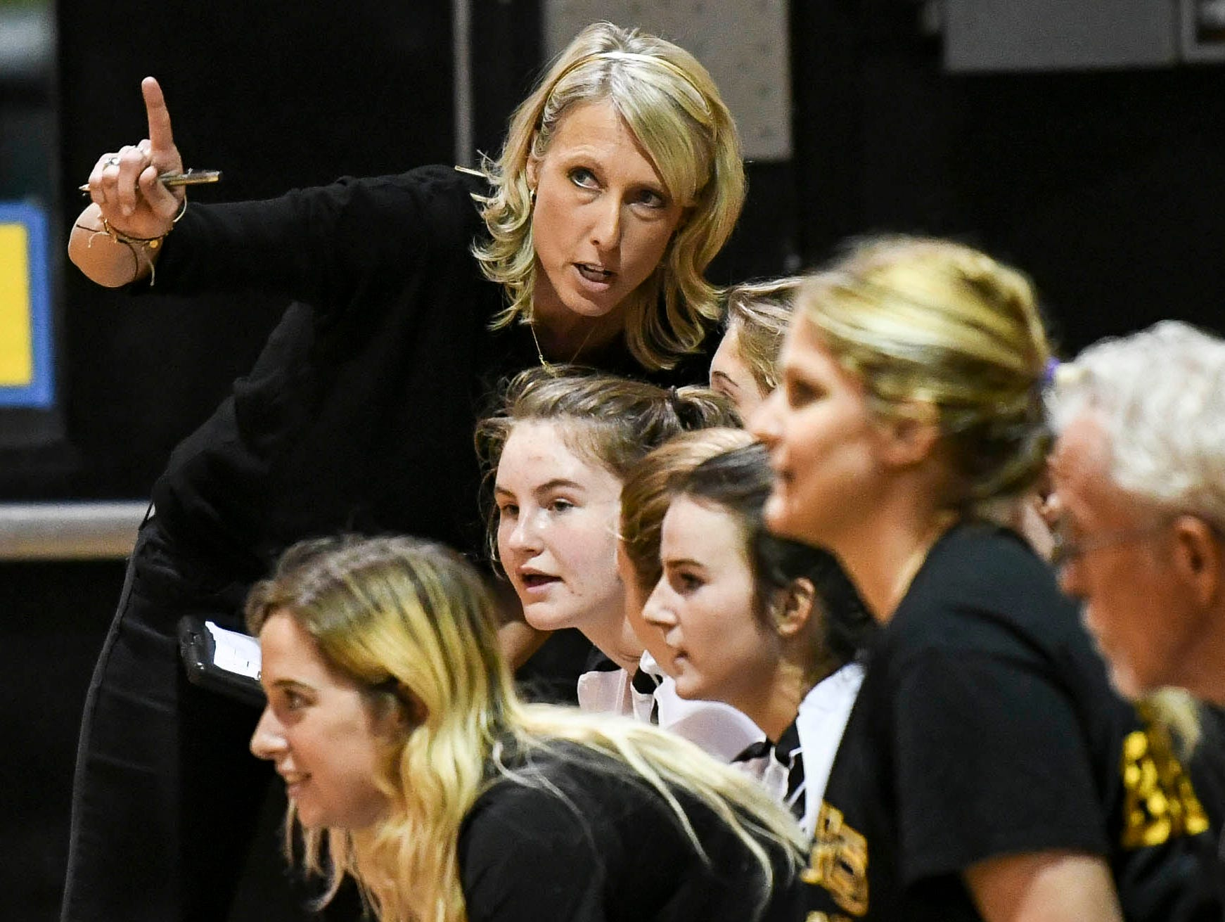 Merritt Island coach Angie Patrick talks with her players during Tuesday volleyball regional semifinal.