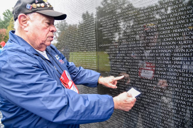 Retired Air Force Maj. George Matthews, who served from 1955-75, looks up a name at the Vietnam Veterans Memorial during the Honor Flight.