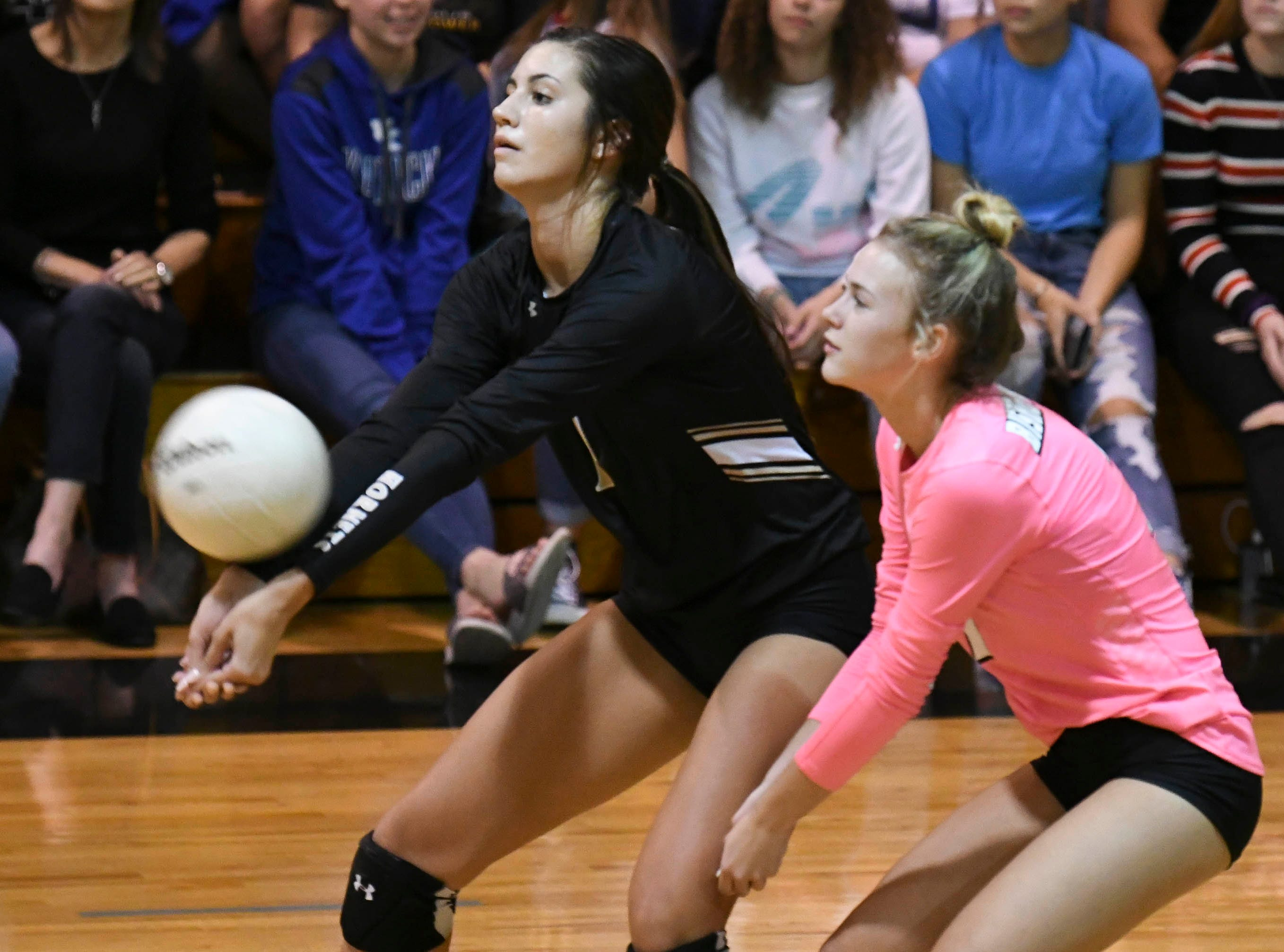 Bishop Moore players go for the same ball during Tuesday volleyball regional semifinal against Merritt Island.