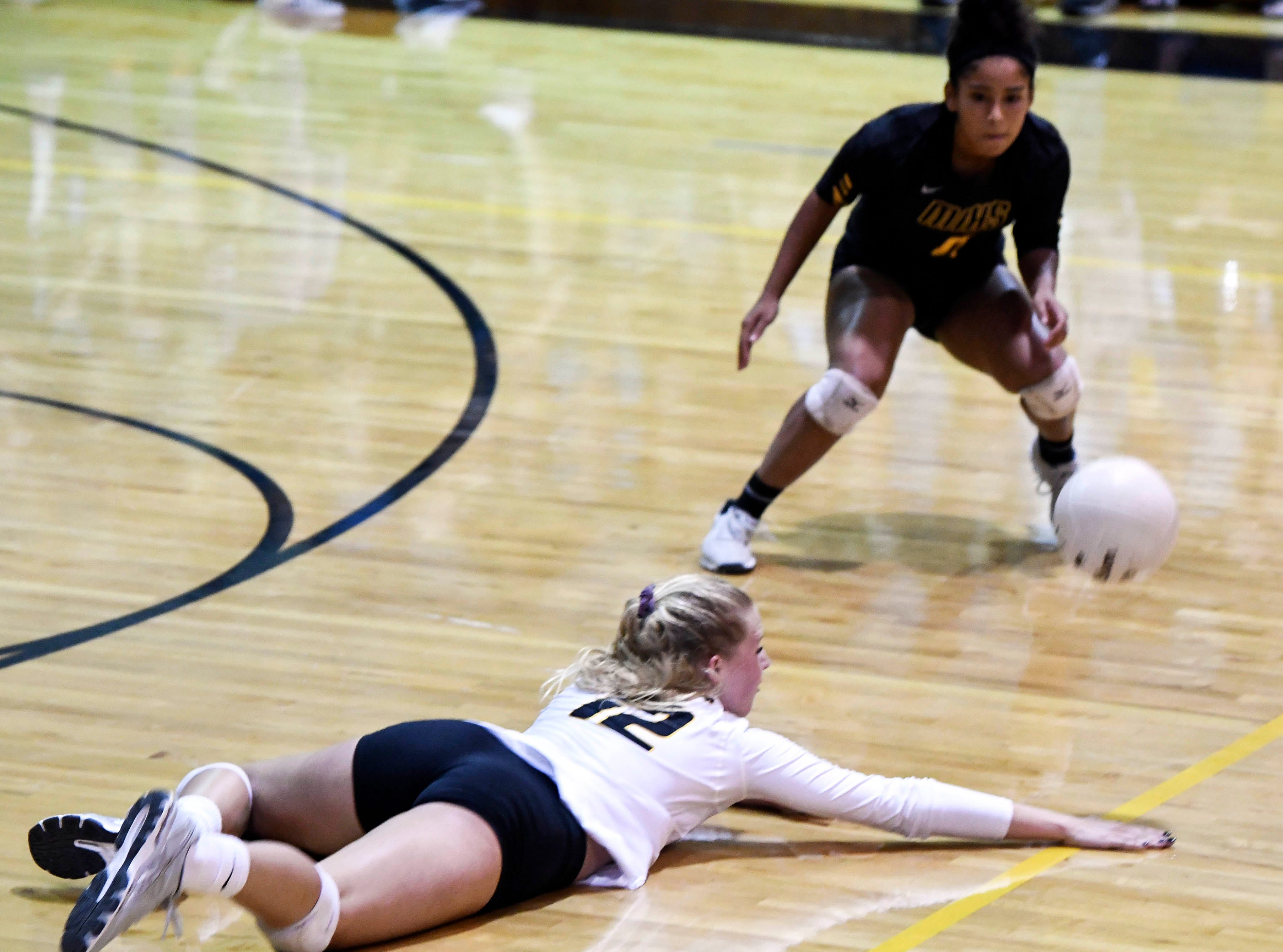 Bobbie Jo Schwantz of Merritt Island dives for a ball during Tuesday regional semifinal against Bishop Moore.