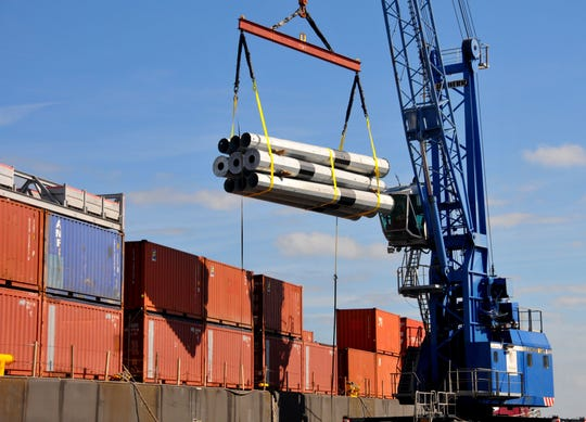 Power poles destined for Puerto Rico are loaded onto the Columbia Baltimore at Port Canaveral's South Cargo Pier 3. Hurricane relief supplies accounted for 37,883 tons of cargo leaving Port Canaveral in the budget year that ended Sept. 30.